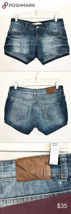 """Zara Denim Shorts Zara denim shorts in a medium wash with intentional fading throughout.  5 pocket style with zip fly and button closure.  Shorts are in excellent condition and have plenty of stretch.  Material tag has been cut but would assume due to feel of fabric and amount of stretch they Are a cotton/spandex blend.  These are European size 38/US size 6, see size tag for reference.   Measurements laid flat: Waist:  14.5"""" Hip:  19"""" Inseam:  2.75"""" Rise:  7"""" *Measurements are approximate…"""