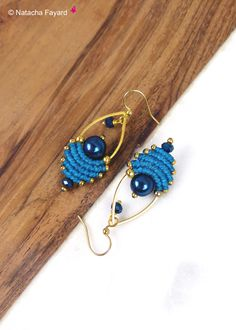 Turquoise blue macrame dangle earrings, drop shape, with miyuki and hematite. © Natacha Fayard #etsy #macrame #earrings #dangle #drop #turquoise #gold #blue #midnight #woven #boho