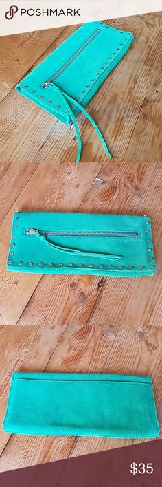 "Banana Republic Green Suede Envelope Clutch Super cute Banana Republic green suede envelope clutch with silver studs.  In really great like new condition.  Approx. Measurements  11"" long 5.25"" high 1"" deep  H❤ppy to answer questions, thanks!❤ Banana Republic Bags Clutches & Wristlets"