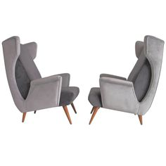 Pair of Mid-Century Modern Italian Armchairs in Grey Velvet | From a unique collection of antique and modern armchairs at https://www.1stdibs.com/furniture/seating/armchairs/