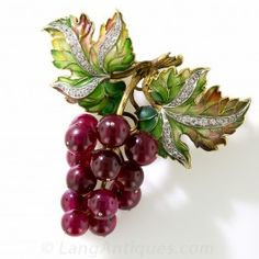 """Plique a Jour Enamel, Diamond and Red Ruby Grape Cluster  Brooch - Art Nouveau Jewelry - Vintage Jewelry - """"Those ripe, red, luscious Cabernet Sauvignon grapes are genuine rubies! Two glorious diamond studded grape leaves are magnificently rendered in shaded plique a jour (translucent) enamel for a luminous effect. We calculate the thirteen ruby grapes to weigh 40 carats total. Wearable as both a pin or pendant."""""""
