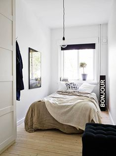 Scandinavian simplicity rules this small monochrome bedroom.