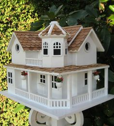Our Williamsburg Cottage Birdhouse places a magnificent summer home right in your backyard.