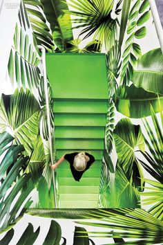 At the marketing agency Barrows, Ghislaine Viñas descends stairs enlivened by wallpaper that she designed with her graphic-designer husband, Jaime, and Jon Sherman of Flavor Paper, who manufactured the wallpaper.