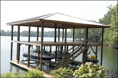 Double Decked Boathouse Incorporating Two Lifts & Metal Hip Roof
