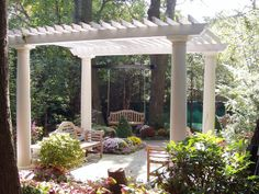 Plantings transform this pergola into an outdoor living room