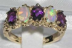 Love the pairing of opals and amethysts, but it's a little too much for me here. I would like it better if the two amethysts on the sides were not there.