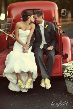 the setting is rustic and represents a style. the shoes are characteristic of the couple and gives the formal attire a twist.