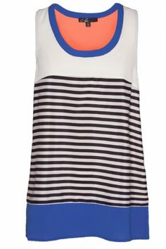 We are completely in love with this C. Luce tank! The vibrant colors and contrasting stripes make it a complete show stopper! $56 #bevello
