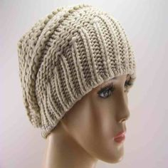 Attractive and warm for the winter days ahead. This is a comfortable medium weight unisex beanie hat in the trendy slouchy style.  Material is 100% acrylic knit.  Size: One size available fits most with flexible knit.