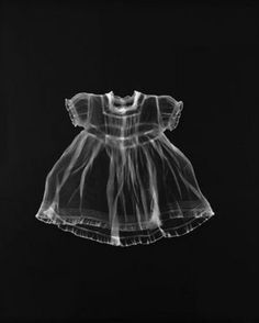 Adam Fuss photogram. I think this photogram is really effective as the dress looks haunted and ghostly.