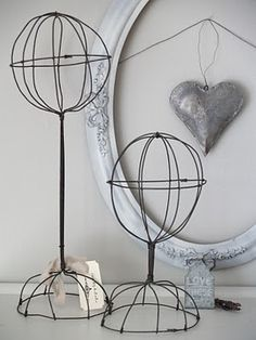 When some look at these vintage wire hat holders, they see just that - a vintage wire hat holder.  When I look at them, I see art in the sweetest sculpture.