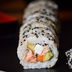 Smoked Salmon Philadelphia Roll Sushi With Sushi Rice, Water, Rice Vinegar, Sugar, Salt, Smoked Salmon, Cream Cheese, Carrots, Nori Sheets, Avocado, Black Sesame Seeds, Soy Sauce, Wasabi Paste, Gari