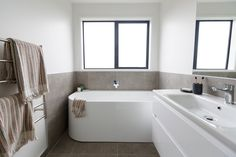 Grey helps to create a sense of calm, which is how the bathroom should feel. #bathroom #bathrooms #interiordesign #bathroombliss #wainuiplan #generationhomesnz Bedroom House Plans, Bathrooms, Bathtub, Calm, How To Plan, Interior Design, Create, Grey, Home