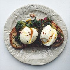 Tomatillo, Spinach And Onion On Toast With Soft-boiled Egg. Get the #recipe and 100+ more Breakdast Egg Ideas at https://feedfeed.info/breakfasteggs?img=1246672 #feedfeed
