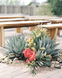 The outdoor aisle was lined with clusters of succulents, coral peonies, and ranunculus that fit the event's peach-and-green palette.