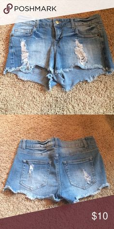 Light wash cut off Jean shorts Light wash cut off Jean shorts with small holes on the front. Only worn a couple of times and in good condition! They stretch and are really comfortable! Forever 21 Shorts Jean Shorts
