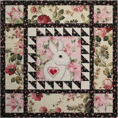 Floral bunny quilt pattern by Darcy Ashton.  [Pinned for the interesting color mixing - pastels with black and white.]