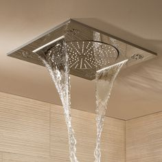 """Grohe Rainshower F-Series 15"""" Multi Spray ceiling-mounted shower 27939001. This shower head from Grohe offers rain, spray and waterfall options for an indulgent shower"""