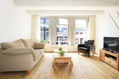 nice bright living room with high windows overlooking the lively street! 726 for nine nights