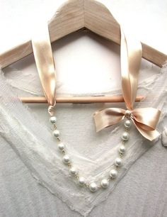 Carrie Bradshaw Inspired Pearl Necklace In  Peach Cream Satin  Ribbon. , via Etsy.