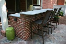 Red Brick Outdoor Kitchen with Raised Seating Bar