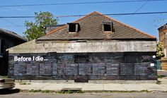 """The wall of an abandoned building in New Orleans was transformed into a place for people to share their goals and dreams by finishing the sentence """"Before I die I want to ____."""""""