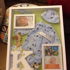 Baby boy going home outfit shadow box I made. I'm so proud of it! :)