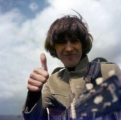 """George Harrison from the Beatles during the filming of """"Help"""" in Salisbury Plain. May 1965"""