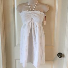 NWT white swimsuit cover up w/center drawstring NWT white swimsuit coverup w/center drawstring & underlay. 100% cotton Fire Los Angeles Swim Coverups
