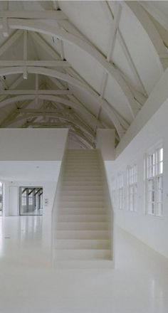 White staircase inside an Atelier Kempe Thill designed conversion of an the former Dutch penal colony Veenhuizen..