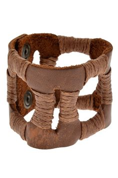 Leather cutout cuff with waxed twine                                                                                                                                                      More