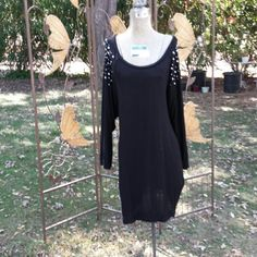 BOGO FREE SALE Long Black Sweater Dress w/Bling This is a long sweater dress you can wear with leggings and a belt if desired. It has bling on both shoulders. Can fit many sizes small to Large depending on if worn with a belt or not ir just how baggy you like your clothes Ocasion Dresses
