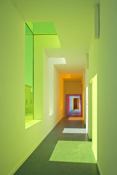 Spanish architect Alejandro Muñoz Miranda's Educational Centre En El Chaparral in Granada, Spain, uses coloured light as a device to define its interior communal spaces. Classroom windows, however, feature colourless glass; photos Fernando Alda