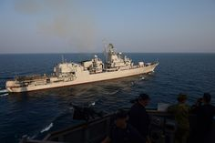 160726-N-FP878-154 BLACK SEA (July 26, 2016) The Ukrainian Frigate Hetman Sagaidalhny (FFHM U130) pulls away from USS Ross (DDG 71) after conducting a replenishment-at-sea during exercise Sea Breeze 2016 July 26.  Sea Breeze is an air, land and maritime exercise designed to improve maritime safety, security and stability in the Black Sea. (U.S. Navy photo by Mass Communication Specialist 1st Class Theron J. Godbold/Released)