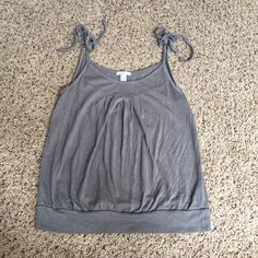 "Old Navy Tie Tank Top Size S Old Navy Tie Tank Top Size S.  Super cute for summer!  Length is 23"" from tie to waist. Excellent condition! Old Navy Tops Tank Tops"