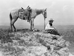 Erwin E. Smith and His Mount Overlooking the Country from a High Point on the JA Ranch, Texas, 1908  Nitrate negative