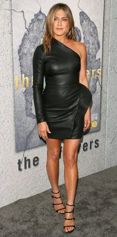 Jennifer Aniston attended the Season 3 premiere of HBO's The Leftovers with her husband Justin Theroux earlier tonight.  The beauty looked sexy as ever in one-shoulder leather mini Brandon Maxwell dress with asymmetrical pleat detailing from the pre-fall 2017 collection. She finished the look with
