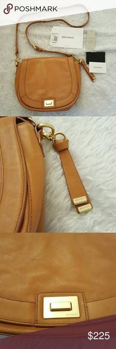 """Brahmin Charleston Sonny in Tan NWT Cross Body Brahmin South Coast Charleston Collection Sonny Saddle Bag  leather flap with turn-lock closure lined interior zip pocket, organizer pocket, pen pocket and key clip inside back slide-in pocket outside removable adjustable strap approx. 8.5 x 10 x 3.75""""; 25"""" strap drop Small scratches on the closure   Brand new with tags. Clean outside and inside. No trading. Please make reasonable offers. Thanks! Brahmin Bags Crossbody Bags"""