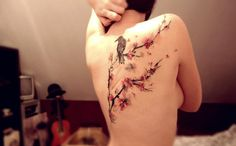 ONDŘEJ KONUPČÍK of Ondrash tattoo, Znojmo, Czech Republic - back tattoo of branches w/ blossoms & bird. I love this piece, the look of brush strokes & size...