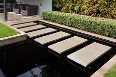 Garden  Pool Design - London - rectangular steps over pond/pool