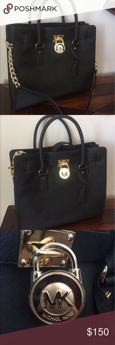 Michael Kors Large Hamilton Black Like new condition barely used, maybe once. There is a small white mark on the edge of the shoulder strap. It's very small and barely noticeable. I have described this item as well as I can. I see no other flaws Michael Kors Bags Shoulder Bags