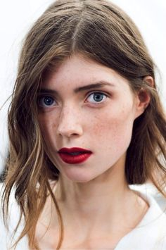 Bold red lips on a bare face = awesomely modern makeup. #lipstick #makeup #beauty
