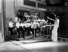 Valaida Snow, renowned musician and composer (1904-1956), conducting an orchestra in London in October 1934.