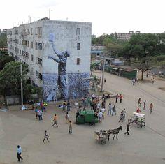 street art in progress, Havana, Cuba. : artists JR and José Parlá