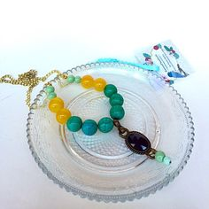 Turquoise strand necklace, made with beautiful semi precious Jade and turquoise stones attached to vintage brass pendant
