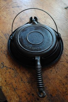i have got to find one of these! Cast Iron Waffle Maker and a Waffle Recipe