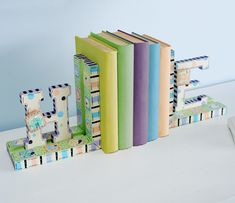 These adorable bookends will make any shelf proud! Learn how to make these Decoupage Bookends with Mod Podge!