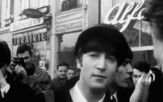 Click on GIF and see John Lennon joking around make a retarded face