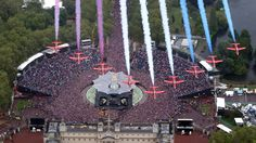 British Royal Air Force Red Arrows fly in formation over Buckingham Palace